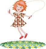 Jumping girl. Redhead girl jumping at the grass Royalty Free Stock Image