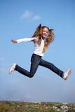 Jumping girl Stock Photos