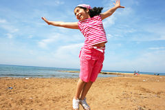 Jumping girl. On the beach Royalty Free Stock Photo
