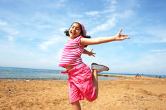 Jumping girl. On the beach Stock Images