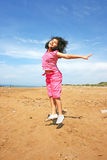 Jumping girl. On the beach Royalty Free Stock Photos