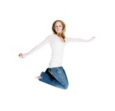 Jumping girl. Pretty girl is jumping with joy in the bright white Royalty Free Stock Image