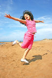 Jumping girl. On the beach Royalty Free Stock Photography