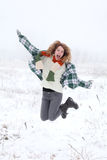 Jumping girl. Young jumping and smiling girl at snow Stock Photography