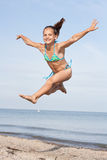Jumping girl Stock Photo