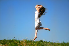 Jumping girl. The girl jumps on a background of the sky Stock Photo