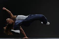 Jumping girl. Girl dancing break-dance style Royalty Free Stock Photo