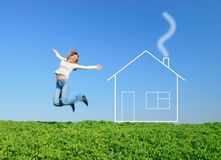 The jumping girl. The girl jumps in the field and dreams about house Stock Photography