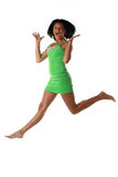 Jumping girl. The jumping girl in a green dress on a white background Royalty Free Stock Photography