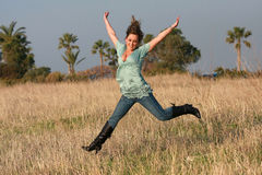 Jumping girl. Autumn jeans outdoors royalty free stock photography