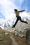 Jumping girl. Hikers on the cliff in mountain, jumping girl Stock Image