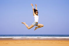 Jumping girl royalty free stock images