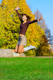 Jumping girl. The jumping girl against the autumn nature Stock Photos