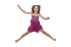 Jumping Girl. Girl in pink dress jumping in the air Royalty Free Stock Image