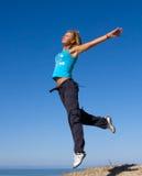 Jumping girl. Blue sky high Royalty Free Stock Photos