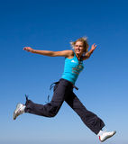 Jumping girl. Blue sky high Stock Photography