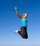 Jumping girl. Blue sky high Stock Image