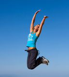 Jumping girl. Blue sky high Royalty Free Stock Photo