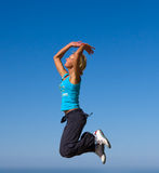Jumping girl. Blue sky high Stock Images