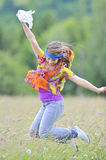 Jumping girl against summer meadow Stock Image
