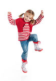 Jumping girl in autumn clothing Royalty Free Stock Images