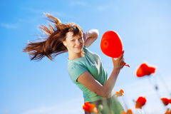 Jumping girl with balloon Stock Images