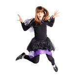 Jumping girl in bat costume Stock Image