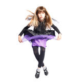 Jumping girl in bat costume Royalty Free Stock Photo