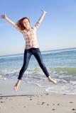 Jumping girl at the beach. Royalty Free Stock Photos