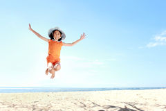 Jumping girl in the beach Stock Photo