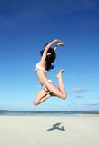 Jumping girl in bikini Stock Photography