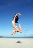 Jumping girl in bikini. In Maldives Stock Photography