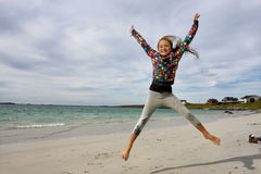 Jumping girl. With blue sky in the background Royalty Free Stock Photo