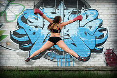 Jumping girl in boxing gloves Stock Photography