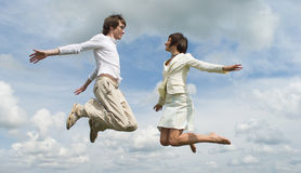 Jumping girl and boy Royalty Free Stock Images