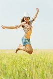 Jumping girl  at field. Jumping girl  at cereals field in summer Stock Photos