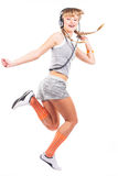 Jumping girl in headphones Royalty Free Stock Photos