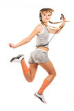 Jumping girl in headphones Royalty Free Stock Image