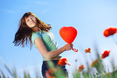 Jumping girl with heart Royalty Free Stock Photography