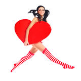 Jumping girl with a heart. Sexy young jumping woman with a big heart in her hands Stock Image