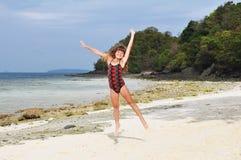 Jumping girl on island Stock Image
