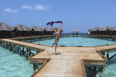 Jumping girl in   the Maldives resort Royalty Free Stock Photography