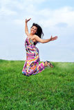 Jumping girl in meadow Stock Photography