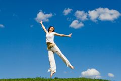 Jumping girl in meadow Stock Photo