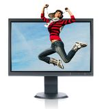 Jumping girl and monitor Stock Image