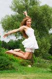 Jumping girl on the nature Stock Photo