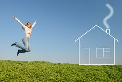 The jumping girl near the dream house Royalty Free Stock Image