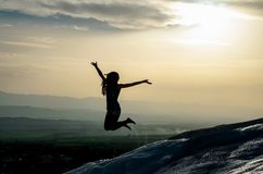 Jumping girl. On the Pamukkale hill, Turkey Stock Image
