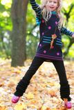 Jumping girl in park Royalty Free Stock Image