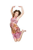 Jumping girl in pink dress Royalty Free Stock Image